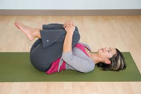knees to chest yoga pose for sciatica relief